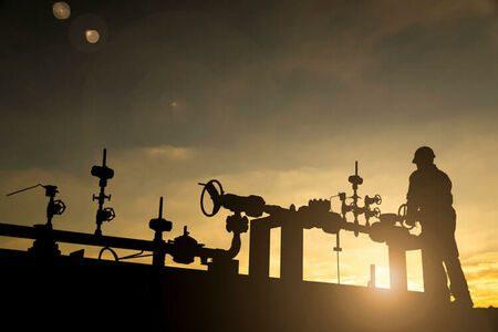 Silhouette of an oilfield worker.